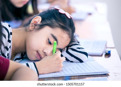 BANGKOK, THAILAND – AUGUST 12: A girl who is sleeping and writing on August 12, 2019 in Bangkok, Thailand.