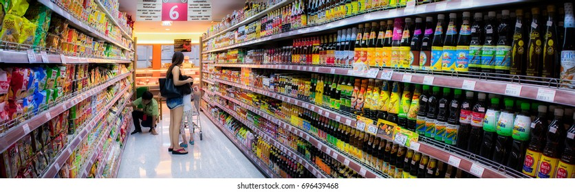 8cf9660dbe402 BANGKOK, THAILAND - AUGUST 12: Unidentified shoppers shop in the soy sauce  aisle in