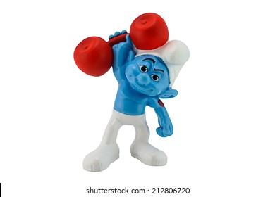 Bangkok, Thailand - August 13, 2014 :Smurf weightlifting character PVC toy figure. There are toy sold as part of McDonald Happy Meal toy.