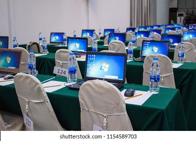 Bangkok, Thailand - August 13, 2018 : Notebook computer showing Logo of Microsoft Windows 7 on the screen with various software on the desktop in conference room.