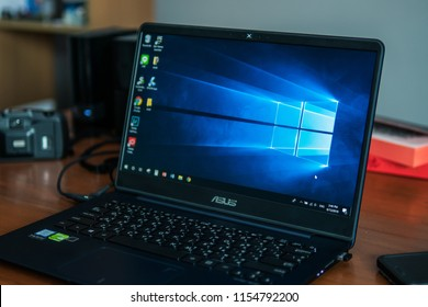 Bangkok, Thailand - August 13, 2018 : Laptop computer showing its screen with Microsoft Windows logo on desktop.