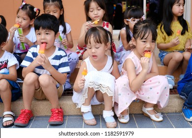 BANGKOK, THAILAND: August 14, 2018 – kids group eating ice cream at a party in Kindergarten Chokchai Rangsit School on August 14, 2018,Bangkok, Thailand