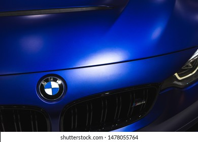 Bangkok, Thailand - August 14, 2019: BMW car logo and grill of the BMW M4 Car, close up on the front side of Blue BMW M4 car.