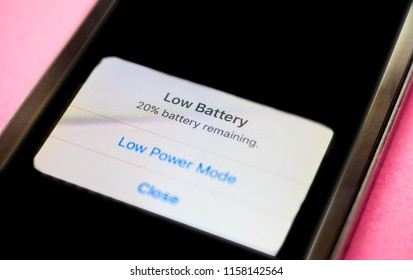 Bangkok, thailand, August 16, 2018: iphone se with low battery alert message pop up on screen, battery issue support on apple website as background, selective focus
