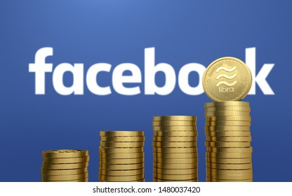BANGKOK, THAILAND - AUGUST 16th, 2019: Gold Libra coin on stack of coins with the Facebook logo background.