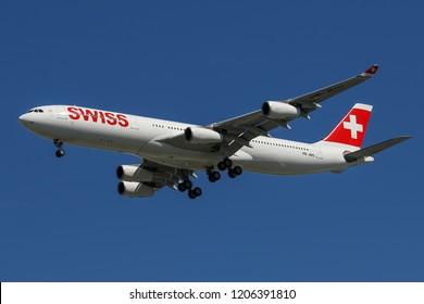BANGKOK, THAILAND - AUGUST 19, 2015: Swiss Airbus A340-300 HB-JMO make final approach runway 19L at Suvarnabhumi (Bangkok ) Airport from Zurich