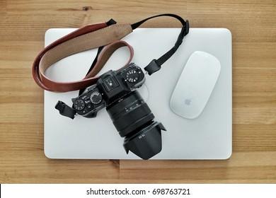 "Bangkok, Thailand - August 19, 2017 Digital Photographer Life: Fujifilm Camera on Apple Macbook Pro 13"" Mid 2014 model with Apple Magic Mouse"