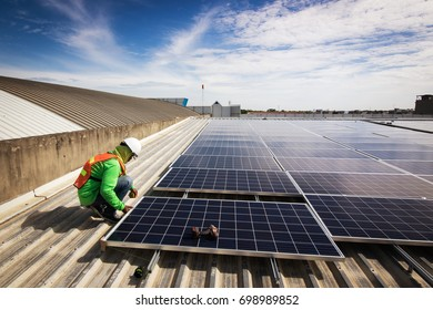 Bangkok, Thailand - August 19,2017 : A technician checking the completeness installation of solar cells, on August 19,2017 in Bangkok, Thailand