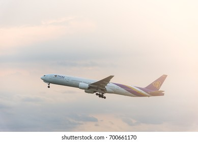Bangkok, Thailand - August 19,2017 : Thai airline after take off under the cloudy sky in the evening with sunset view from the Suvarnabhumi Airport of Bangkok Thailand.