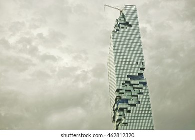 BANGKOK, THAILAND - AUGUST 2, 2016: MahaNakhon skyscraper wiht gray clouds in Bangkok, Thailand. It is a luxury 77 floor and currently under construction in central business area of Bangkok.