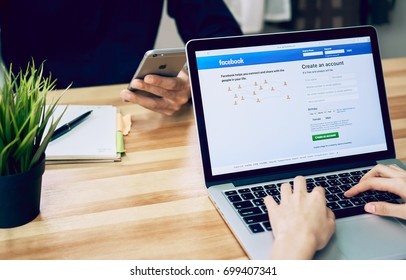 Bangkok, Thailand - August 20, 2017 : Woman is playing laptop showing screen facebook.  facebook largest and most popular social networking site in the world.