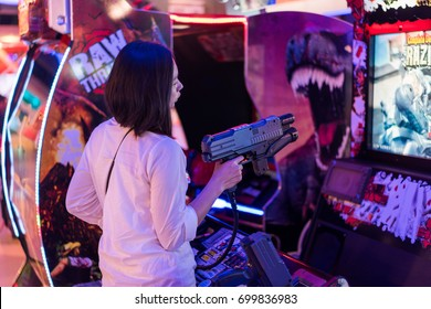 BANGKOK, THAILAND - August 20, 2017 : Asian woman play shootting game at the shopping mall. Bangkok is one of the worlds top tourist destination cities.