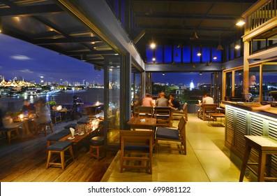 BANGKOK - THAILAND AUGUST 20, 2017:The 342 Bar.360 Panorama Rooftop Bar.Overlooks the Wat Arun Temple ,Wat Phra Kaew or Temple of the Emerald Buddha
