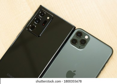 BANGKOK - THAILAND AUGUST 20 2020 : Close up Compare of new triple rare camera of  The New Samsung Galaxy Note 20 Ultra 5G and Apple iPhone 11 Pro Max on table , Bangkok, Thailand on August 20,2020.