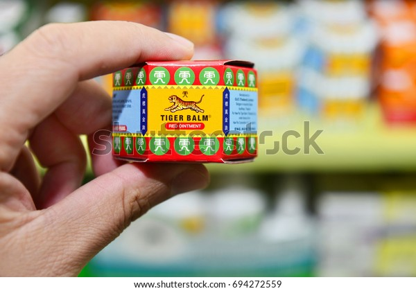 BANGKOK, THAILAND -August 2017 : Handle Packages of Tiger Balm in drugstore Bangkok, Thailand on August 11, 2016. Tiger Balm is medicinal ointment made from herbs that has pain-relieving remedy