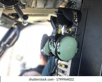 Bangkok, Thailand- August 20,2020: Pilot headset on the wall or Pilot headphones. Headphones for pilots. Aviation headphones for pilots or radio headphone for flight crew