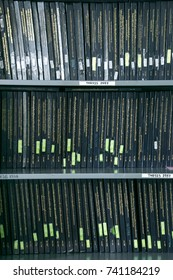 BANGKOK, THAILAND - August 21 2017 : Row of Dark Green Thesis Book on the Shelf in the Public Library of King Mongkut's University of Technology Thonburi for Research Project, Blurred Educa