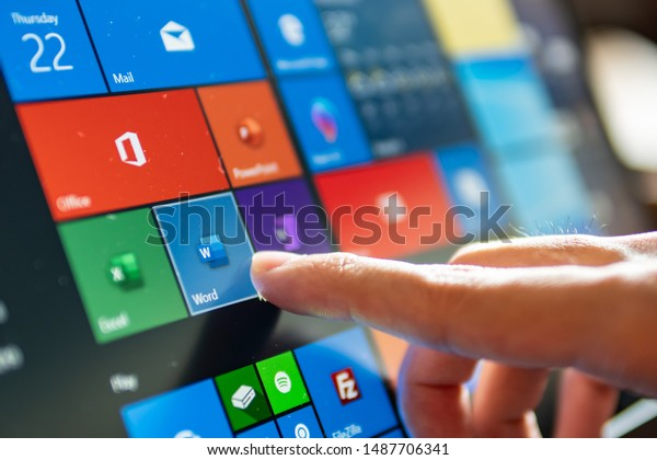 Bangkok, Thailand - August 22, 2019 : Computer user touching on Microsoft word icon to open the program.