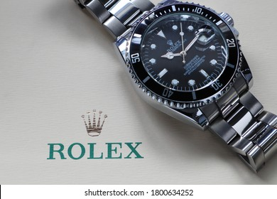 Bangkok Thailand - August 22 , 2020 : The Rolex wristwatch model black oyster perpetual submariner date display on the white background of Rolex crown logo
