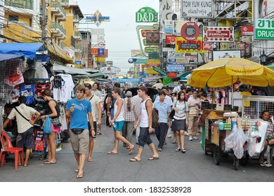 Bangkok, Thailand - August 23, 2012: Tourists walk along backpacker haven Khao San Road. Famous for its nightlife and market, accommodation in the Khao San area starts from $6 or B200 per night.