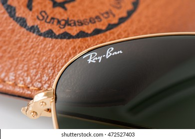BANGKOK, THAILAND - AUGUST 23, 2016: Details of Ray-Ban Caravan with gold frame. Ray-Ban is a brand of sunglasses and eyeglasses founded in 1937 by American company Bausch & Lomb.