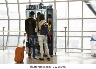 BANGKOK, THAILAND - AUGUST 23 : Foreigner travlers lovers buying food and drink from Automatic vending machine at Suvarnabhumi international airport on August 23, 2017 in Bangkok, Thailand