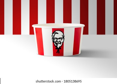 BANGKOK, THAILAND - August 24, 2020:  Illustrative editorial image of KFC soft drink paper cup on red striped background. KFC is an American fast food restaurant chain known as Kentucky Fried Chicken.