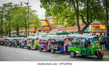 Bangkok - Thailand , August 25 - 2016 : Tuk Tuk taxi waiting customers on street at Wat Phra Chetupon Vimolmangklararm (Wat Pho) temple in Thailand.