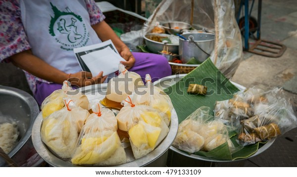 Bangkok - Thailand , August 25 - 2016 : Thailand vendors are selling thai style desserts on the side road at Wat Phra Chetupon Vimolmangklararm (Wat Pho) temple in Thailand.