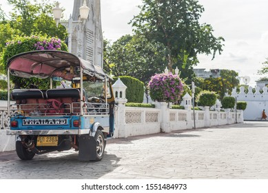 Bangkok, Thailand - August 25, 2019 : Thai TukTuk taxi running for passenger service on the road in Bangkok, Thailand. Tuk-Tuk is a motorcycle have a three-wheeler (Tricycle).