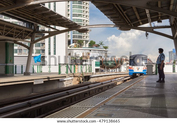 Bangkok, Thailand - August 27, 2016 : Unidentified security guard on BTS skytrain train runs in Bangkok. Many people in Bangkok used skytrain to save time.