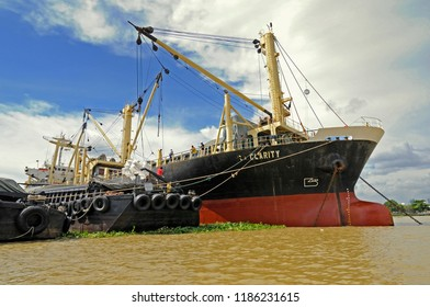 bangkok, thailand - august 28, 2008: the general cargo vessel isa clarity (imo 8601393) loading  rice in bags ex barges midstream at anchorage on mae nam chao praya river