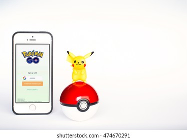 "Bangkok, Thailand - August 28, 2016 : Pokemon Go popular reality game application on iPhone with Pokeball and Pikachu figure ; a famous cartoon character from animation and smartphone app ""Pokemon GO"""