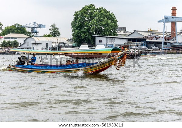 Bangkok, Thailand - August 28, 2016 : Boat driver service for Tourist the popular boat travel on the Chao Phraya river. To stay in downtown Bangkok. And tourist attractions on both sides of the river.