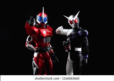 "BANGKOK, THAILAND - August 28, 2018:Close up of S.H.Figuarts Kamen Rider Accel and Kamen rider""w""fang joker from tv series"