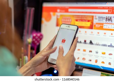 Bangkok, THAILAND - August 29,2018: woman holding i-phone with icons of shopee; E-commerce and online shopping on screen.smartphone lifestyle,shoopee app concept.