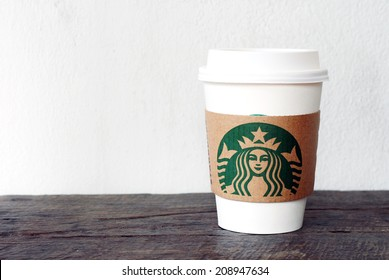 BANGKOK, THAILAND - August 3, 2014: A cup of Starbucks coffee. Starbucks is the world's largest coffee house with over 20,000 stores in 61 countries.