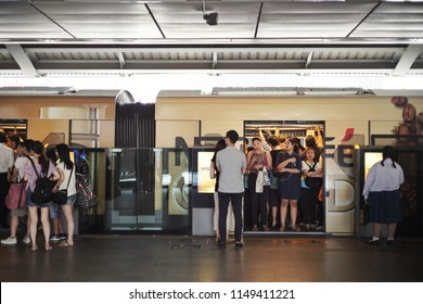 Bangkok, Thailand - August 3, 2018 : Unidentified crowd people on BTS skytrain train platform at Siam BTS skytrain station