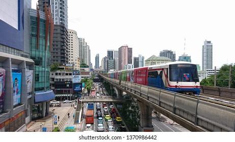 BANGKOK, THAILAND - August 3, 2018 : BTS Skytrain or The Bangkok mass Transit System Skytrain running on sukhumvit line near victory monument station