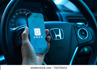 BANGKOK, THAILAND - AUGUST 30, 2017 : Driver starting uber application, Uber is smartphone app-based transportation network.