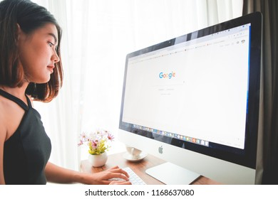 Bangkok. Thailand. AUGUST 30, 2018:  A woman is typing on Google search engine from a laptop. Google is the biggest Internet search engine in the world.