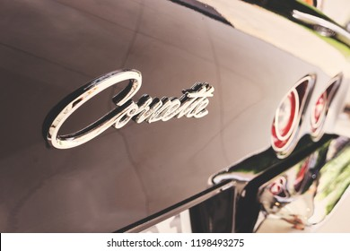 BANGKOK, THAILAND - AUGUST 31, 2017: Rear view of black Chevrolet Corvette Stingray with reflection on chrome bumper. Illustration of classic car & vintage car. Vintage American muscle car logo.