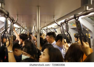 Bangkok Thailand - August 31, 2017: Full the passengers standing and waiting inside BTS skytrain, Busy and packed with people in rush hour, Transportation of the Bangkok Mass Transit System