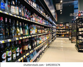 Bangkok, Thailand - August 31, 2019: Wine and beer various brands (bottle and can) on shelves in a supermarket. Beverage consumption overall in Thailand has increased in recent years.