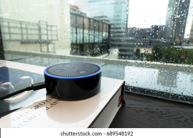 BANGKOK, THAILAND - August 4 : Selective focus on Amazon Echo dot version 2, the voice recognition streaming device from Amazon on table. August 4 2017 in Bangkok , THAILAND.
