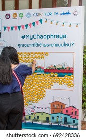Bangkok, Thailand - August 5, 2017: People place smile face stickers on picture wall, concept of strong expression or votes for agreement or argument of urban community modern development projects