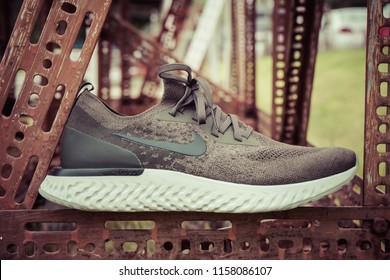 BANGKOK , THAILAND - AUGUST 5, 2018 : Product shoot of Nike men's running shoe, Nike Epic React Flyknit on old steel,