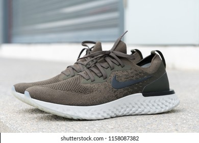 BANGKOK , THAILAND - AUGUST 5, 2018 : Product shoot of Nike men's running shoe, Nike Epic React Flyknit on cement floor
