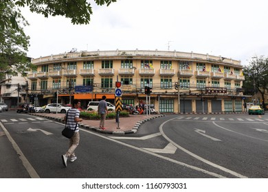 Bangkok, Thailand - August 5 2018 : Old vintage yellow long building at Bamrung Muang Road and tourist is walking across the street.