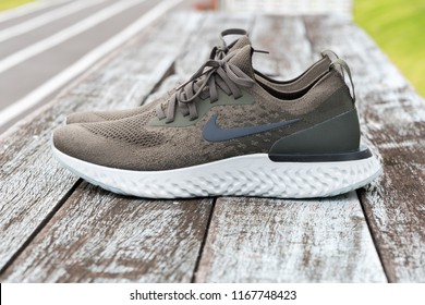 BANGKOK , THAILAND - AUGUST 5, 2018 : Product shoot of Nike men's running shoe, Nike Epic React Flyknit on wooden background.